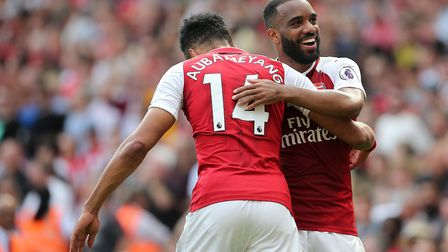 Arsenal's Alexandre Lacazette (left) celebrates scoring his side's fourth goal of the game with Pier