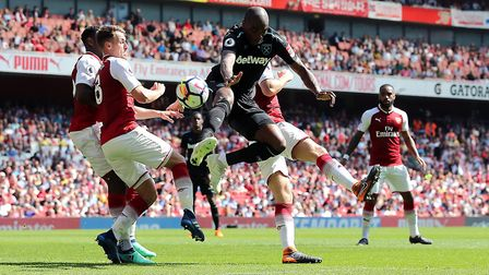Arsenal's Aaron Ramsey (left) and West Ham United's Angelo Ogbonna (centre) battle for the ball (pic