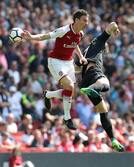 Arsenal's Laurent Koscielny (left) and West Ham United's Marko Arnautovic (right) battle for the bal