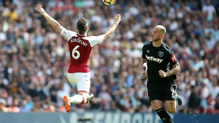 Arsenal's Laurent Koscielny (left) and West Ham United's Marko Arnautovic (right) in action during t