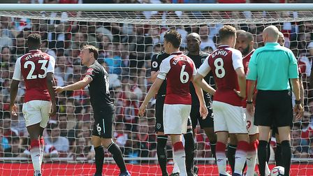 Arsenal's Danny Welbeck (left) and Mark Noble exchange words (pic Mark Kerton/PA)