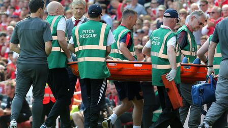 Arsene Wenger looks on as Arsenal's Mohamed Elneny is stretchered off with an injury (pic Mark Kerto