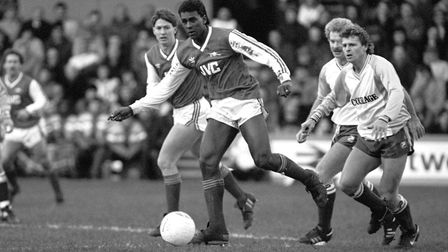 Arsenal's David Rocastle takes control of the ball with team mate Tony Adams alongside, and Reading'