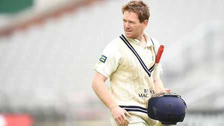 Middlesex batsman Eoin Morgan leaves the field after being trapped lbw by Lancashire's Junaid Khan i