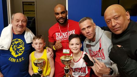 Islington youngster Alfie Suksiri with coaches Nyron Hughes and Chad Ouzman and Lion opponents (pic