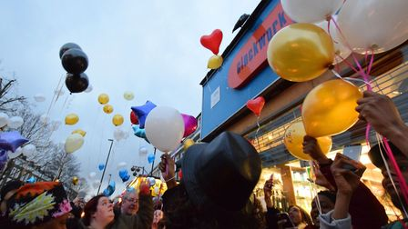 Family, friends and neighbours release balloons outside Clockwork Pharmacy in Caledonian Road during