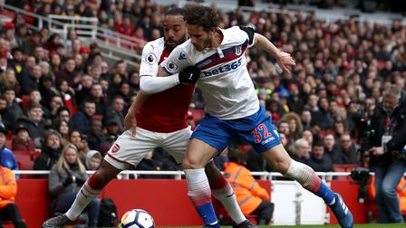 Arsenal's Alexandre Lacazette (left) and Stoke City's Ramadan Sobhi battle for the ball during the P