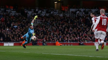 GOAL!!! Alexandre Lacazette of Arsenal scores past a diving Igor Akinfeev of CSKA Moscow in the UEFA