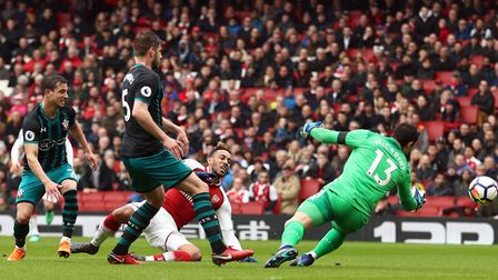 Arsenal's Pierre-Emerick Aubameyang (centre) scores his side's first goal against Southampton (pic T