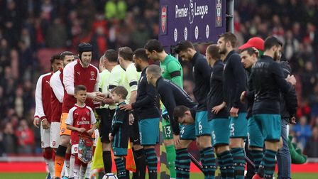Arsenal and Southampton players shake hands before the Premier League match at the Emirates Stadium