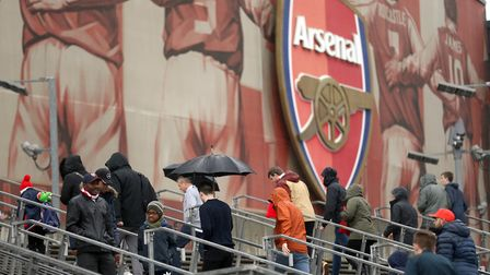 Fans arrive for the Premier League match at the Emirates Stadium (pic Tim Goode/PA)