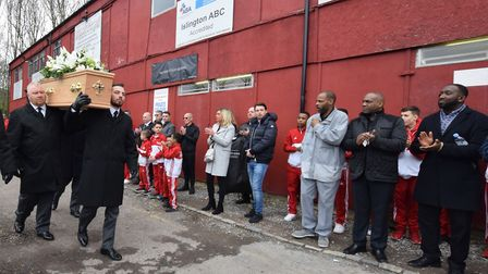 Friends and family applaud as Ron Hagland's funeral procession starts from Islington Boxing Club. Pi