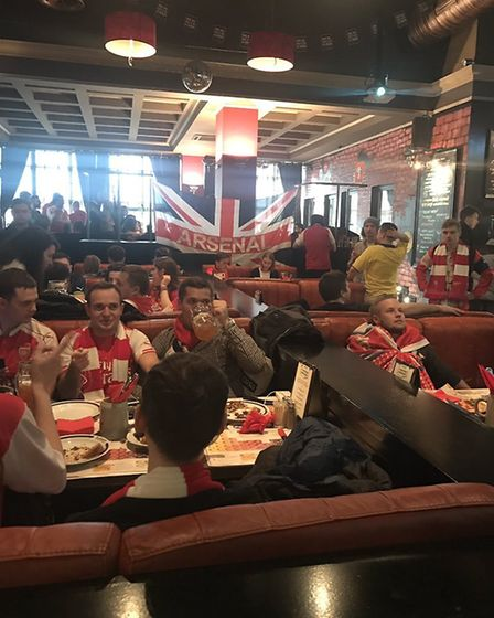Dee Conway with Arsenal fans prior to kick off in Moscow