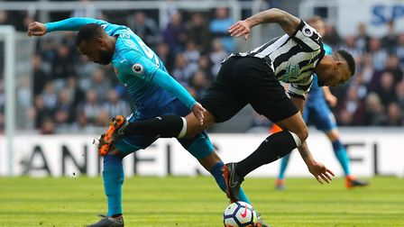 Arsenal's Alexandre Lacazette (left) and Newcastle United's Jamaal Lascelles battle for the ball dur