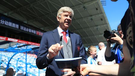 Arsenal manager Arsene Wenger signing autographs ahead of his final match in charge before the Premi