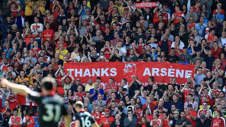 Arsenal fans supporting outgoing manager Arsene Wenger in the stands before the Premier League match