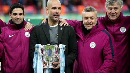Manchester City manager Pep Guardiola (centre) with Mikel Arteta (left), Brian Kidd (right) and Dome
