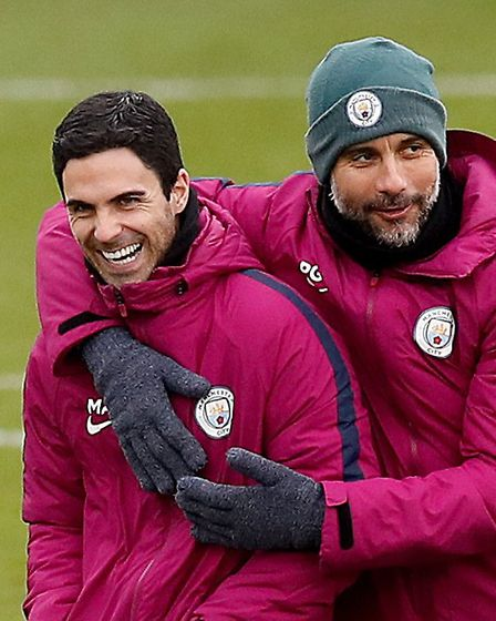 Manchester City manager Pep Guardiola (right) with assistant coach Mikel Arteta (left) during the tr