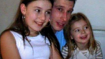 Robert Duff with his two daughters. A murder investigation has now been launched over the dad's disa