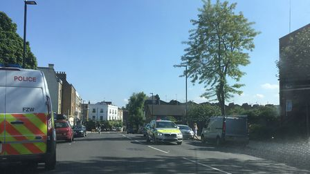 Police in Roman Way yesterday afternoon. Picture: James Morris
