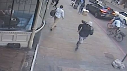 A handout image of a male running from the scene in Upper Street after last night's fatal stabbing.