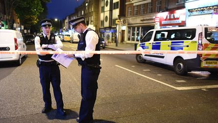 Police at the scene of the stabbing in Upper Street last night. Picture: Victoria Jones/PA Wire