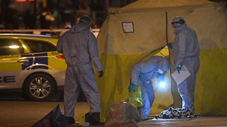 Forensic officers at the scene of the stabbing in Upper Street last night. Picture: Victoria Jones/P
