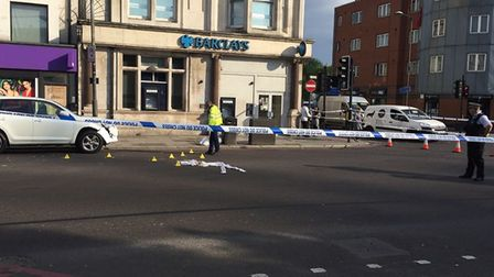 Police taped off Seven Sisters Road after the crash.