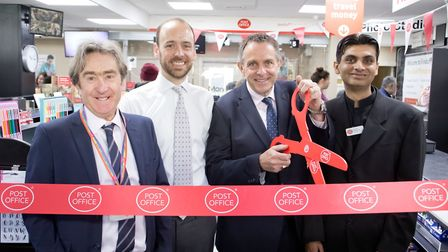 Rizwan Salahuddin, right, with Post Office bigwigs at the official opening of the franchised branch