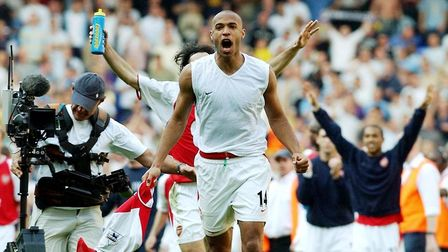 Arsenal's Thierry Henry celebrates after the Barclaycard Premiership game against Tottenham Hotspur