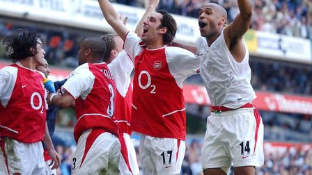 Arsenal's Thierry Henry with Edu (second right) as they celebrate amongst team-mates after the Barcl
