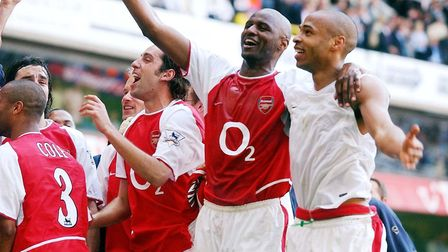 Arsenal's Thierry Henry with Patrick Vieira (second right) as they celebrate amongst team-mates afte