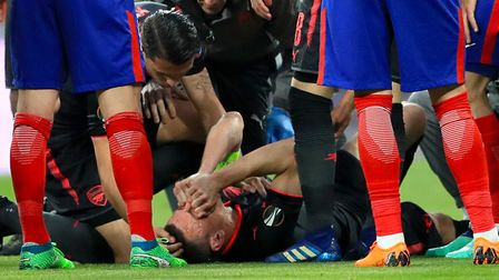 Arsenal's Laurent Koscielny receives medical attention during the UEFA Europa League, Semi Final, Se