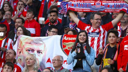Arsenal fans hold a banner with an image of manager Arsene Wenger on it (pic Adam Davy/PA)