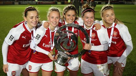 Arsenal Women celebrate winning the Continental Tyres Cup Final at Adams Park, Wycombe.
