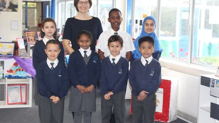 Wilberforce Primary School headteacher Claire Macfie (pictured with students) has been credited with