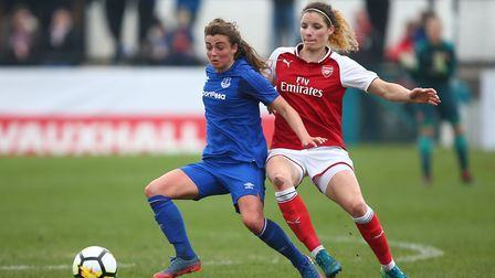 Everton Ladies' Jodie Brett and Arsenal Women's Dominique Janssen (right) battle for the ball during