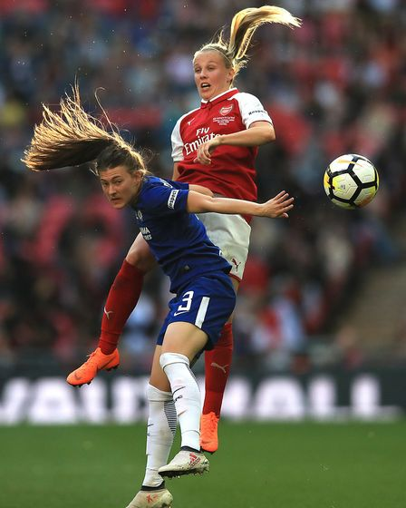Chelsea Ladies' Hannah Blundell (right) and Arsenal Women's Beth Mead (right) battle for the ball du