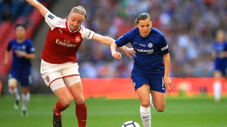 Arsenal Women's Louise Quinn (left) and Chelsea's Fran Kirby (centre) battle for the ball during the