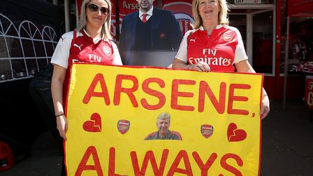Arseanl fans Kate Foster and Lynn Tate holding a banner celebrating manager Arsene Wenger before the