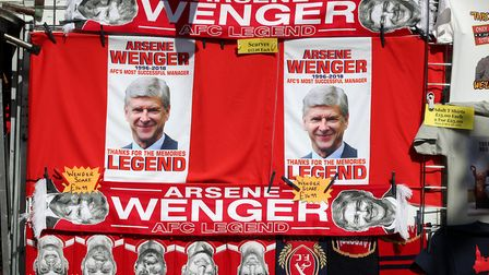 Memorabilia of Arsenal manager Arsene Wenger on sale outside the ground before the Premier League ma