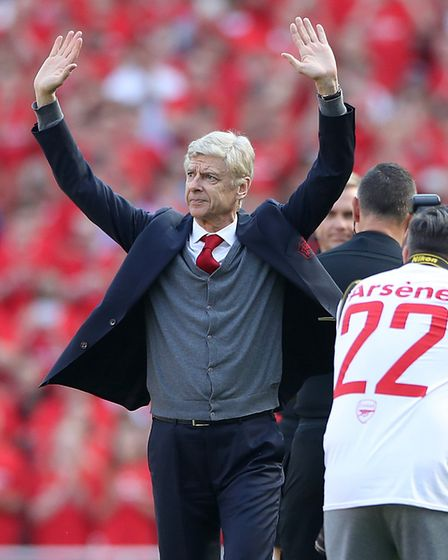 Arsenal manager Arsene Wenger salutes the fans before the Premier League match at the Emirates Stadi