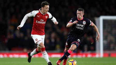 Arsenal beat Huddersfield Town's 5-0 at the Emirates in November. Mesut Ozil and Town's Jonathan Hog