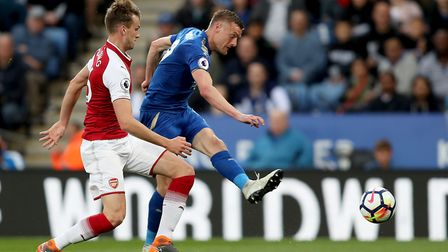 Leicester City's Jamie Vardy has a shot on goal during the Premier League match at the King Power St