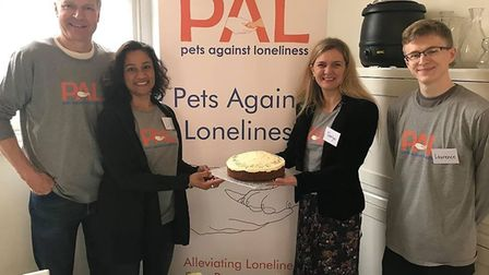 Pets Against Loneliness meets at New Unity Meeting House. Founder Lyn Ambrose, second left, is pictu