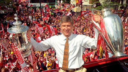 Arsene Wenger at Islington Town Hall with the league and FA cups in 1998. Picture: John Stillwell/PA