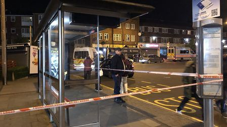 Police at the scene of the shooting in Queensbury. Picture: @keval_91/PA Wire