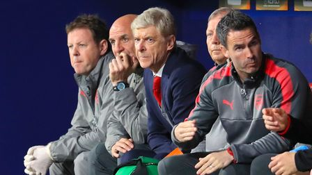 Arsenal manager Arsene Wenger looks on from the dugout (pic Adam Davy/PA)