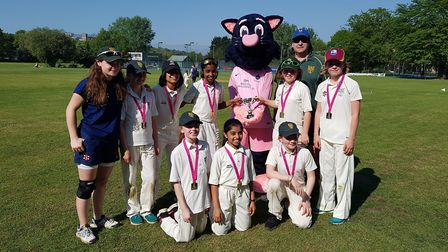 Pinky the Panther, the Middlesex cricket mascot helps North London's under-11 girls lift the Lady Ta