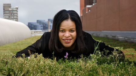 Cllr Claudia Webbe in a PR shot admiring a rare orchid on a 'green roof' in Holloway. Picture: Islin